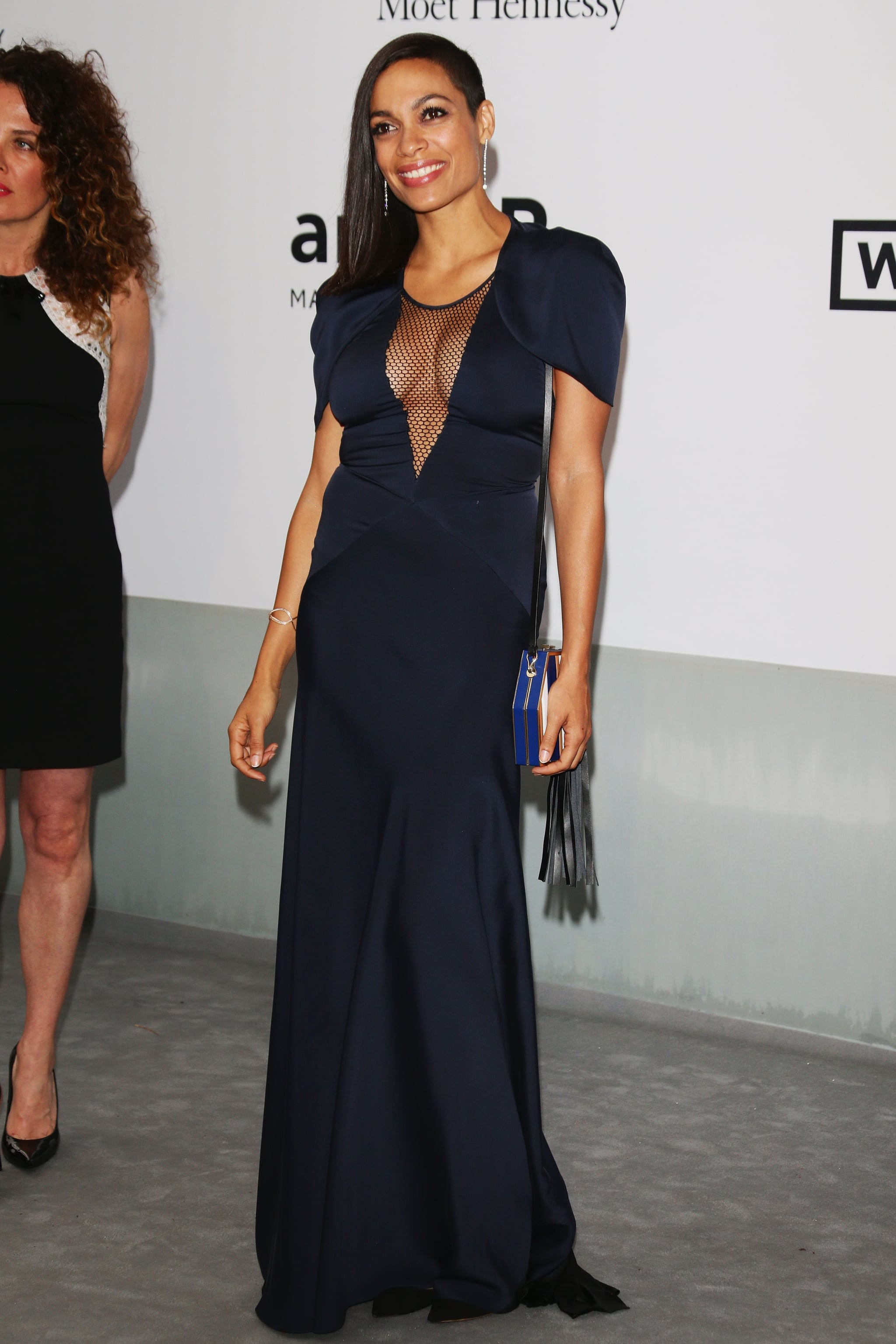 Rosario Dawson showed off her cleavage in a low-cut gown.