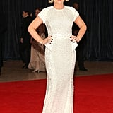Amy Poehler opted for a bright white peplum-trimmed confection.