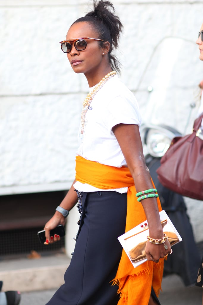 Quirky specs, a touch of tribal jewels and high-wattage color gave this t-shirt and skirt combo added interest. Source: Greg Kessler