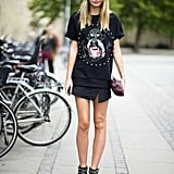 Give your basic t-shirt a Fall twist with a schoolgirl-feeling skirt and ankle boots, like her rocker-chic Chloé pair. Source: Adam Katz Sinding