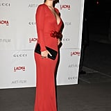 Olivia Wilde in a tight red dress.