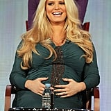 Jessica Simpson clutched to her pregnant belly during a January 2012 TCA panel discussion for Fashion Star in LA.