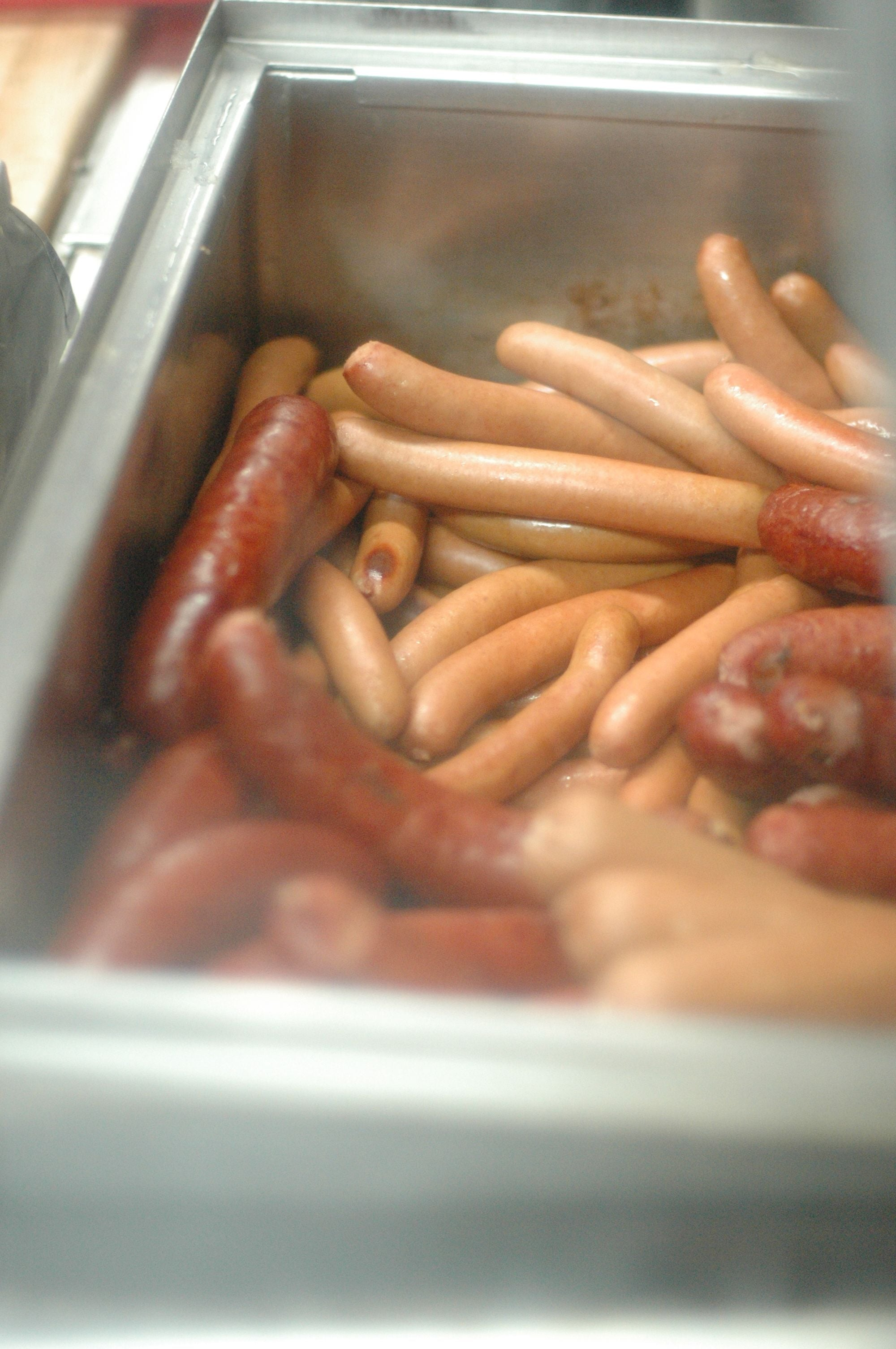 These hot dogs and sausages are waiting for you to order them.