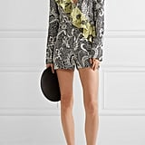 Who could pass up a feminine romper from DVF? The Ruffled Wrap-Effect Printed Silk Crepe De Chine Playsuit ($270) will take you from the beach to brunch.