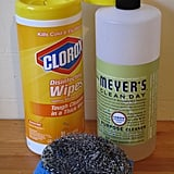 Begin armed with serious ammunition: you'll need all-purpose cleaner, a sponge and hot water, and a steel wool scrubber in case you have gnarly spills to clean up. I threw in disinfectant wipes for good measure.