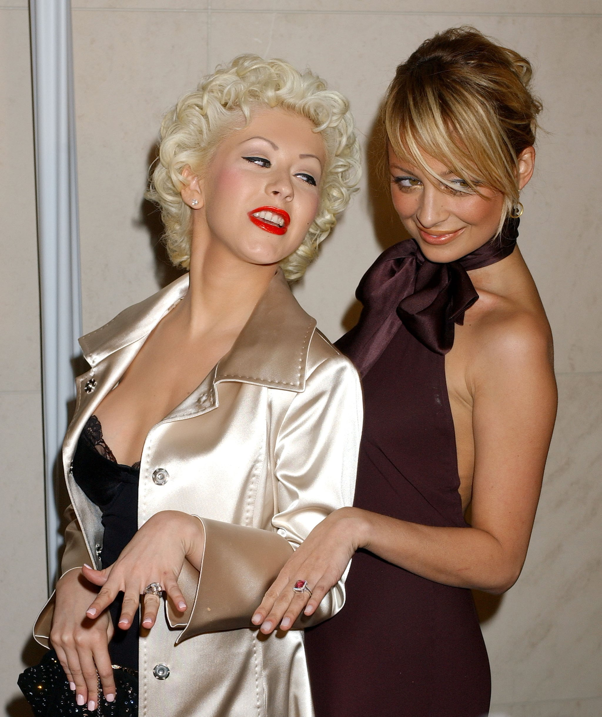Nicole and Christina Aguilera showed off their shiny new engagement rings — courtesy of DJ AM and Jordan Bratman, respectively — at a Roberto Cavalli store opening in LA in February 2005.