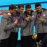 Ryan Lochte, Michael Phelps, Conor Dwyer, and Ricky Berens showed off their gold medals after the 4 x 200 relay.  Source: Twitter user esqright