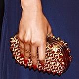 Nicki Minaj played up the punk vibe with a spiked gold clutch in hand.