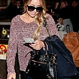 Lauren Conrad wore a Rag & Bone knit sweater and sunglasses at the Los Angeles airport.
