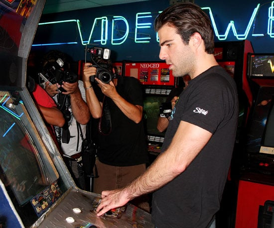Photo Slide of Zachary Quinto Playing Arcade Games in NYC