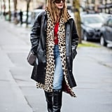 Style Your Leopard-Print Coat With: A Leather Jacket, Bright Sweater, Jeans, and Tall Boots