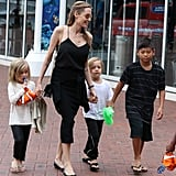 Angelina Jolie held hands with twins Vivienne and Knox on the way to Sydney Aquarium on Sept. 8.