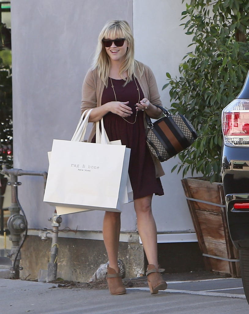 Reese Witherspoon smiled as she left the Rag & Bone boutique in Beverly Hills yesterday. She rocked her favorite pair of booties from the brand as she carried a handful of shopping bags out of the store. Yesterday's outing was just the latest in a week of fun shopping sprees. On Wednesday, Reese flashed a smile during a stop at Neiman Marcus, and earlier in the week, she was spotted shopping in celebration of her son Deacon, who turned 9 on Monday. Amidst her retail run, news broke that she may be getting back into the singing game as well. It is rumored that Reese will duet with Michael Bublé  for an upcoming project.