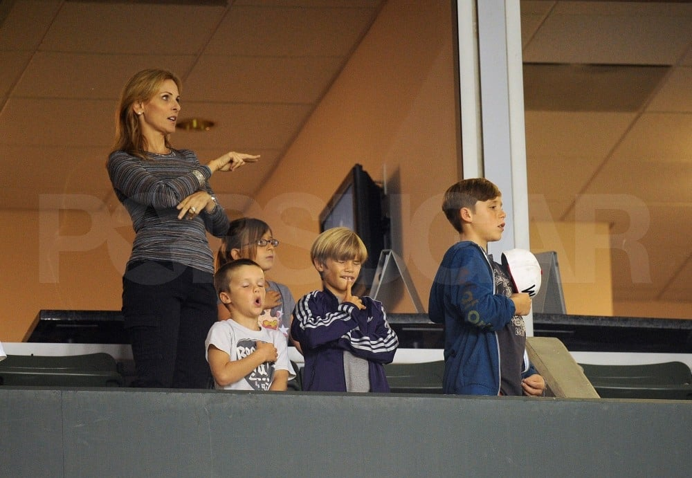 Cruz Beckham, Brooklyn Beckham, and Romeo Beckham sang at their father's soccer game.