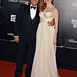 Jessica Chastain posed with Giorgio Armani on the red carpet at the Haiti: Carnival in Cannes event.