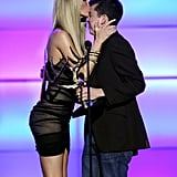 Christopher Mintz-Plasse got a kiss from Marisa Miller in 2008.