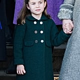 Princess Charlotte wore a dark green coat and black tights while attending the Christmas Day Church service at Church of St. Mary Magdalene in December 2019.