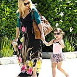 Charlotte Prinze waved while holding hands with Sarah Michelle Gellar.