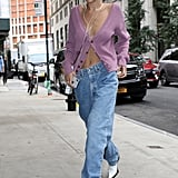Bella Hadid Wore Baggy Jeans and a Purple Cardigan in Between Shows During NYFW