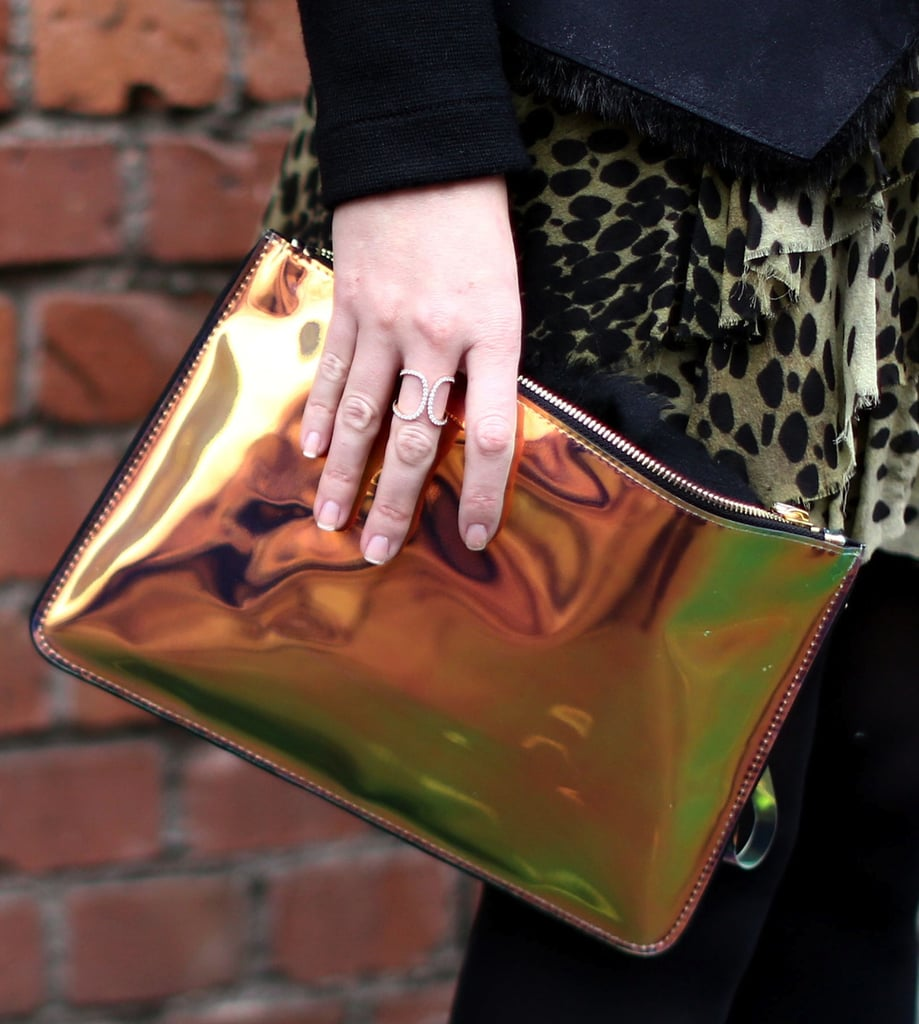 An iridescent clutch added a metallic shimmer to darker accompaniments.