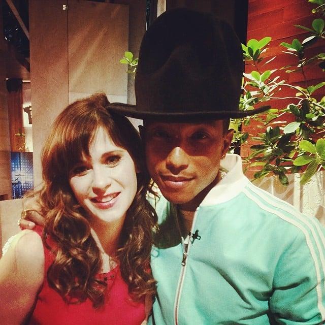 Zooey Deschanel cozied up to Pharrell Williams and his hat. Source: Instagram user zooeydeschanel