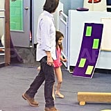 Tom Cruise and Suri Cruise play together.