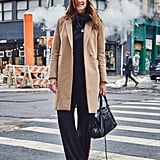 On Fashion Director Hannah Weil McKinley: H&M coat, Nike hoodie, Zara pants, and Balenciaga bag