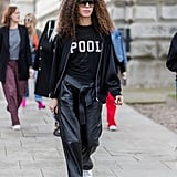Create an All-Black Look With a Graphic or Team Tee and Leather Pants