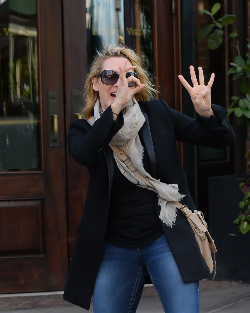 """Monday marks a big milestone for Kate Winslet — it's her 40th birthday! The actress couldn't contain her excitement for the big day as she left an NYC building in the morning flashing a huge grin and putting up a """"40"""" sign with her fingers for the cameras. Kate's had a busy few weeks leading up to her birthday; she premiered The Dressmaker at the Toronto International Film Festival in September, and just last week she started press rounds for the new Steve Jobs movie. Her promotional appearances included a glamorous red carpet stop during the New York Film Festival on Saturday and a chat with The Wall Street Journal during which she got pretty candid about her past relationships."""