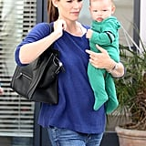 Jennifer Garner carried Samuel Affleck wearing a blue sweater.