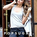 Miranda Kerr posed in front of a cafe during a Victoria's Secret photo shoot.