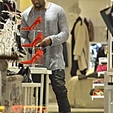 Kanye West checked out some shoes.