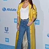 Her bright yellow floor-length duster jacket made a simple outfit of jeans and a white tee a little extra special.