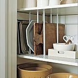 Keep cutting boards and trays easily accessible by installing tension rods.
