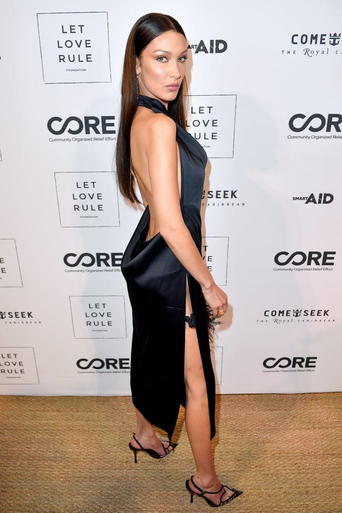 Bella Hadid is never one to disappoint with her fashion choices, but the 23-year-old model took things up a notch while spending some time at Miami's Art Basel event this week. After hanging out on beach with Kendall Jenner in a cheeky black bikini on Thursday, Bella got fancy and stepped out at the CORE x Let Love Rule charity event wearing a Bevza black slip dress that was basically a high-fashion version of a mullet: conservative in the front and sexy in the back.  The silky number featured a draped cowl neckline, a thigh-high slit on the left side, and an open back. She accessorized with a gold body chain designed by Chrome Hearts, a furry Dakota Jinx handbag, and Juan Vidal heart slingback pumps. Read ahead to get a look at Bella's dress from all angles.      Related:                                                                                                           No, That's Not a Magazine Cover — It's Bella Hadid in a Groovy Cutout One-Piece