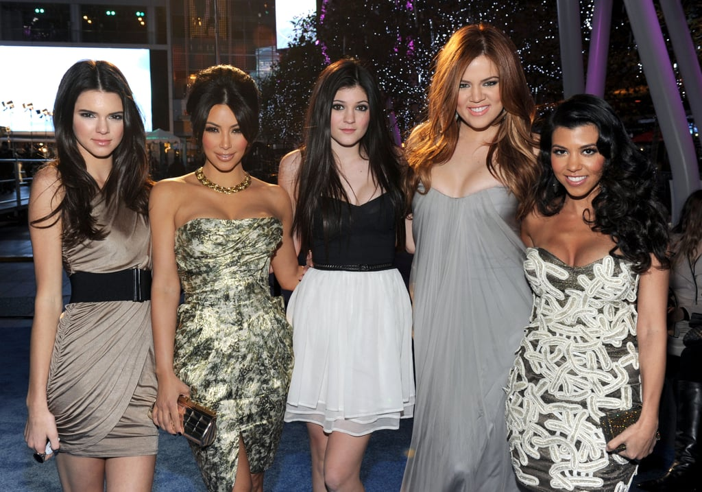 The five Kardashian sisters all hit the blue carpet together at last night's People's Choice Awards in LA. Kim looked sexy in her strapless dress, though this time Khloe stole the show with her shocking new hair colour. She's in the process of dying it red and says after tomorrow it will be even more Jessica Rabbit-esque. What do you think of the girls' looks? Weigh in on all of them with Fab and Bella's love it or hate it polls!