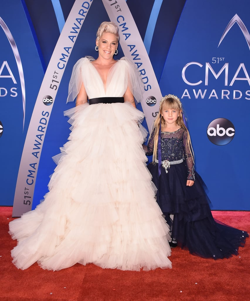 "Pink and her 6-year-old daughter, Willow, wore whimsical fairy-tale dresses while walking the CMA Awards red carpet on Wednesday night, and they looked like two real-life princesses. The 38-year-old ""What About Us"" singer opted for an off-white ruffled dress, while Willow donned a studded black dress and a crown. Although she was dressed to impress, Pink jumped into mummy mode when she stopped to help Willow with her hair on the carpet.   In August, Pink accepted the Michael Jackson Video Vanguard Award at the VMAs and gave a heartwarming speech about teaching her daughter to be true to herself. Her soulful performance at the 51st annual country music event received a standing ovation, and we love that she brought her daughter along to enjoy the festivities while leaving the boys, husband Carey Hart and son Jameson, at home. Read on to see more adorable photos of Pink and Willow on the red carpet, plus photos from her soulful performance ahead.      Related:                                                                                                           The Sweetest Pictures of Pink and Her Family"