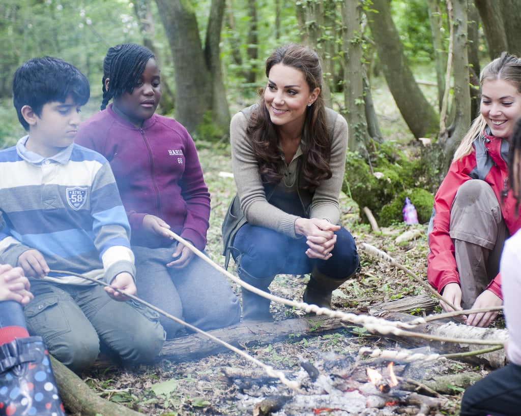 Kate Middleton got close to a group of campers when she made a visit to a school in Kent, England, back in June 2012.