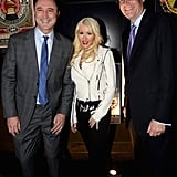 Christina Aguilera made an appearance at the Delta party, posing with two Delta execs.