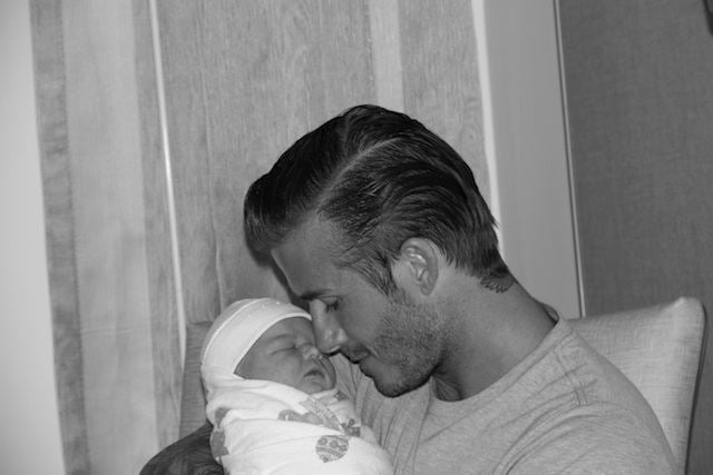David Beckham nuzzled in close to baby Harper Seven in a photo he posted to Facebook on July 17, 2011.