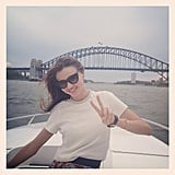 Miranda Kerr flashed a peace sign while cruising the Sydney Harbor. Source: Instagram user mirandakerrverified
