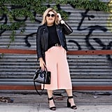 Toughen Up Your Light Pink Pants With Black Leather Pieces
