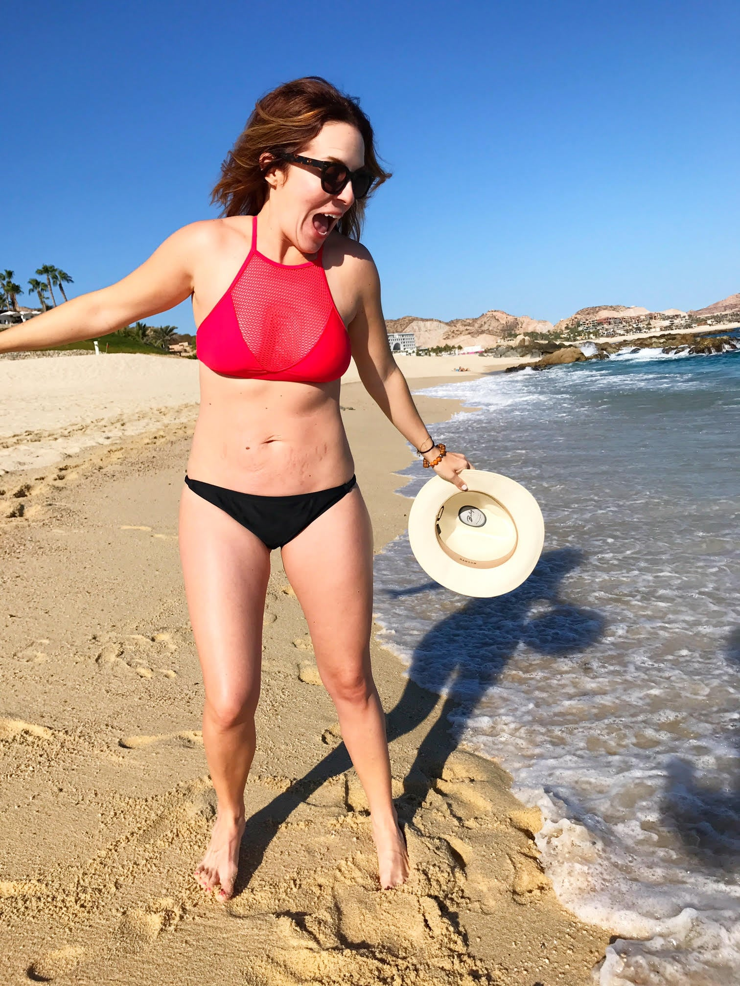 With her slim body and Light brown hairtype without bra (cup size 40B) on the beach in bikini