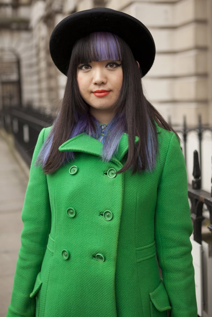 On this stylish gal, black and purple hair looked sassy and sweet with heavy fringe and tangerine lipstick.
