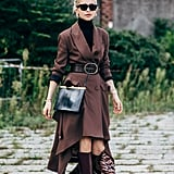 Style leather knee-high boots with a long blazer dress and turtleneck.