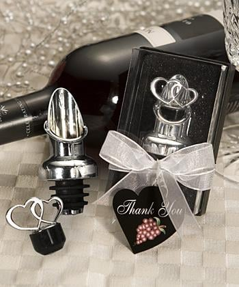 """For the wine fans, try this heart-themed wine pourer/stopper. If you don't like hearts, don't miss out on this dollar sign """"for richer or pourer"""" version."""