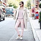 Even if you're not ready for a thick sweater, piling on layers of pastels or neutrals somehow feels lighter and appropriate for early September. Source: Instagram user weworewhat