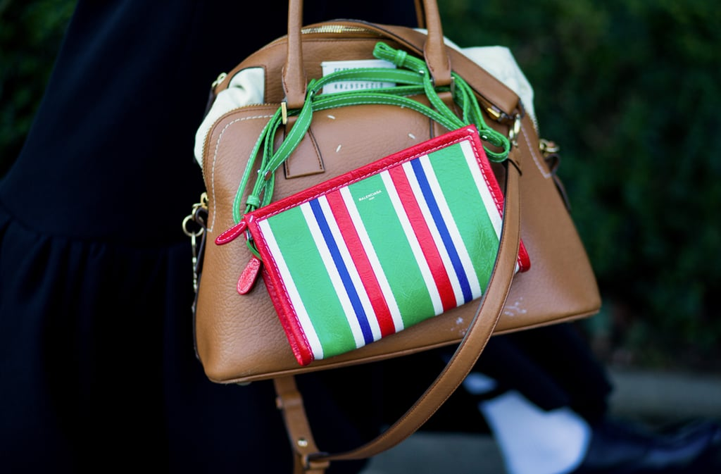 Wrap the rope of your crossbody around the handles of your tote.