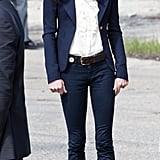 July 6th, 2011 Touring fire-damaged parts of Slave Lake, Alberta.   Kate wears a navy Smythe blazer over a ruffled ivory blouse, J Brand jeans, and a brown Linda Camm belt. Her shoes are Imperia espadrilles by Pied a Terre.