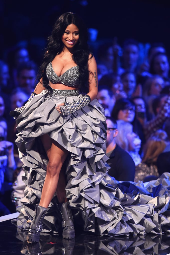 """Ariana Grande, Nicki Minaj, and many more stars flooded into Glasgow, Scotland, on Sunday to attend the 2014 MTV Europe Music Awards. Nicki acted as host for the show, making a grand entrance wearing a dress with an extremely long train. Ariana held her own on the stage too, as she performed in a futuristic leotard. Both Nicki and Ariana were big winners at the event, with Ariana nabbing the award for best song for """"Problem"""" and Nicki winning a statue in the best hip-hop category. Other big names at the show included Ed Sheeran, Sharon and Ozzy Osbourne, and David Hasselhoff, who paid homage to the show's location by donning a kilt. Keep reading to see all the best pictures from the event!"""